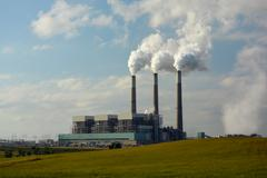 Coal Power Plant with Carbon Dioxide Coming from Smokestacks. Stock Photos