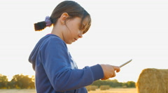 Girl using tablet PC. 4K 30fps ProRes (HQ) Stock Footage