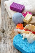 Set for a bath. Towels, soap, scrub, aromatic bomb. Stock Photos