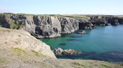 North coast of Cornwall with clear blue sea near Treyarnon PAN Stock Footage