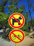 Prohibiting signs no-dogs and no-bikes closeup - stock photo
