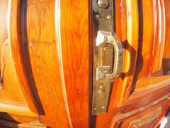 Old bronze door handle close-up on a wooden red door Kuvituskuvat
