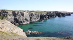 North coast of Cornwall with clear blue sea between Treyarnon and Porthcothan Stock Footage