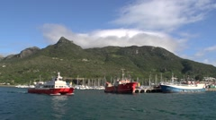 Stock Video Footage of Colourful harbour with boats.Wide shot