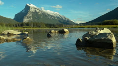 Wide shot of the Vermillion lakes with the Rundles in the background Stock Footage