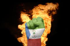 fire fist with the national flag of equatorial guinea - stock photo