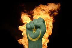 Fire fist with the national flag of mauritania Stock Photos