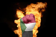 Fire fist with the national flag of sudan Stock Photos