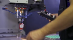 Stock Video Footage of The worker adjusts calibration of cnc machine tool