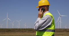 Inspector Engineer Report Man Talking Phone Wind Turbines Power Plant Farm Field Stock Footage