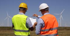 Technician Looking Drawings Men Planning Wind Turbines Windmills Farm Engineers Stock Footage