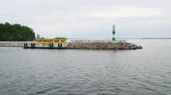 Stock Video Footage of Green Beacon on rocky pier
