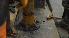 Immersing casing pipe into the borehole Stock Footage