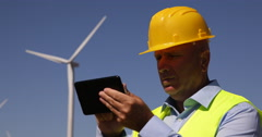 Windmills Spin Engineer Worker Man Using Digital Tablet Modern Tech Wind Turbine Stock Footage