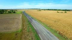 Aero Flight over the road between fields - stock footage
