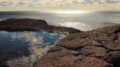 Pool of water in rocks on the ocean Stock Footage