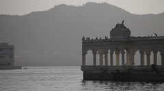 birds flying near the lake palace lake pichola udaipur - stock footage