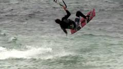 Stock Video Footage of Kitesurfer tries a 360 turn and wipes out