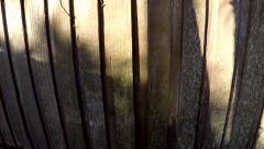 Sunset reflected off fence - time lapse zoom in - stock footage