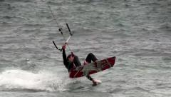 Kitesurfer does a 180 degrees turn in the air Stock Footage