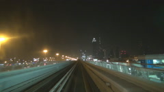 Stock Video Footage of POV Point of view metro train journey famous Dubai city modern skyscraper night
