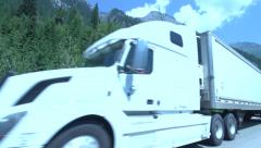 White Semi Truck Drives Past on Freeway - stock footage
