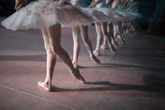 Dancers in white tutu synchronized dancing - stock photo