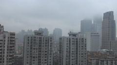 Aerial view Guangzhou financial district skyscraper dangerous rain cloud typhoon Stock Footage