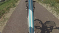 pedaling on a bicycle on the asphalt bicycles line - stock footage