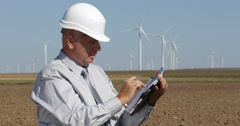 Engineer Worker Prospect Plans Man Work Calculating Wind Turbines Windmills Farm Stock Footage