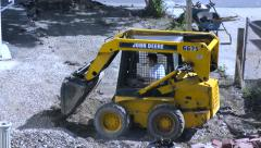 Tractor Front Loader, construction site machinery - stock footage
