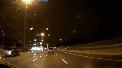 POV driving at night on highway 401 Toronto in the rain dashcam video Stock Footage