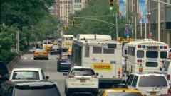 Urban Manhattan scenery busy street traffic New York City NYC cars commute day - stock footage