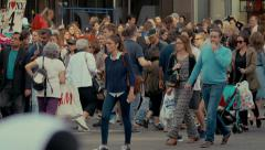 Crowd people crossing zebra pedestrians Manhattan NYC New York City day Stock Footage