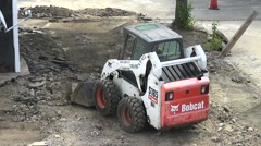 Bobcat tractor front loader, construction machinery Stock Footage