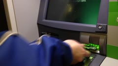 Detail of mans hand deposit a cheque an ATM. Stock Footage