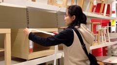 Woman measuring the furniture size at Ikea store Stock Footage
