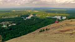 Gondola descending off Stone mountain on a bright cloudy day - stock footage