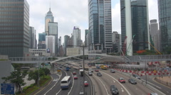 Aerial view busy traffic car freeway multiple lane Hong Kong business center day Stock Footage