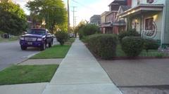 Walking on Sidewalk in Residential Neighborhood Stock Footage