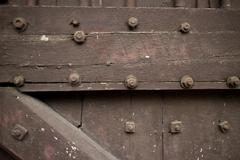 Close up of Heavy wooden door of a temple in Asia studded with bolts - stock photo