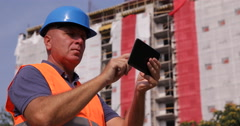 Man Using Digital Tablet Engineer Work Under Development Construction Building Stock Footage