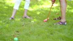Mature Black Friends Playing Croquet Outside in a Park - stock footage