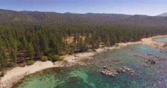 Stock Video Footage of Scenic aerial flight over beautiful beach at Lake Tahoe in Nevada. 4K UHD.