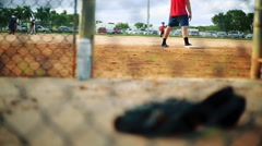 Baseball glove inside a dugout during practice Stock Footage