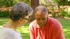 Mature Black Man Celebrates while Playing Croquet in a Park - stock footage