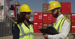 An African American woman discussing logistics with a manager on digital tablet Stock Footage