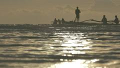 Silhouettes of Philippines Fishermen on Horizon in Boat in Sunrise Light, Bohol, - stock footage