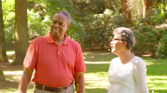 Mature Black Woman Celebrates while Playing Croquet in a Park - stock footage