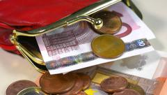 Tilt up to a purse containing Euro coins and bank notes. Stock Footage